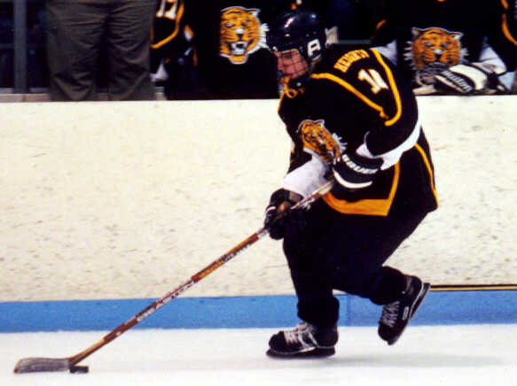Doug Turner cruises past the Tigers' bench.
